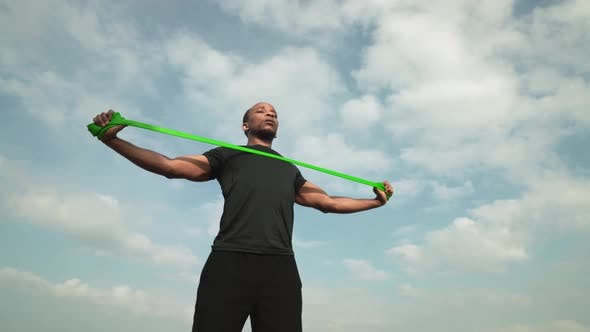 Thumbnail for Handsome African Guy Using Power Band for Strength Training