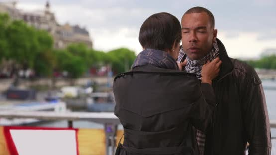 Thumbnail for Pretty African girlfriend fixes up boyfriend's outfit on cold day in Paris