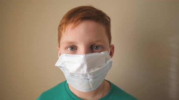 Thumbnail for Portrait of Little Boy with Medical Face Mask Looking at Camera. Sad Male Child Wearing Protective