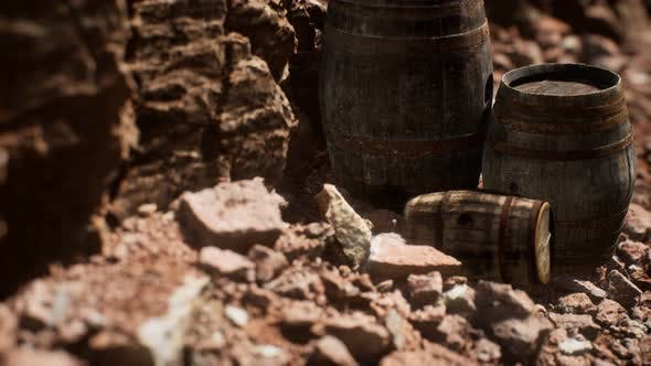 Old Wooden Vintage Wine Barrels Near Stone Wall in Canyon