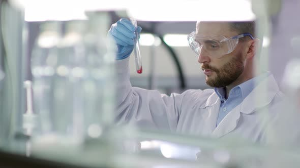 Thumbnail for Scientist Making Experiment in Lab