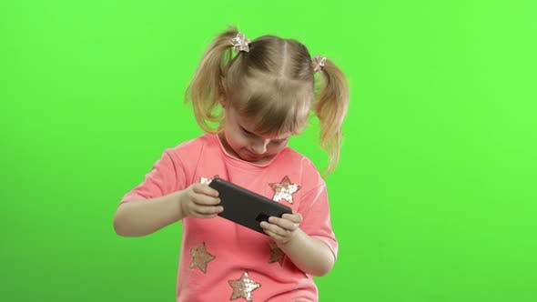 Thumbnail for Little Girl Using Smartphone. Portrait of Child with Smartphone Texting, Playing