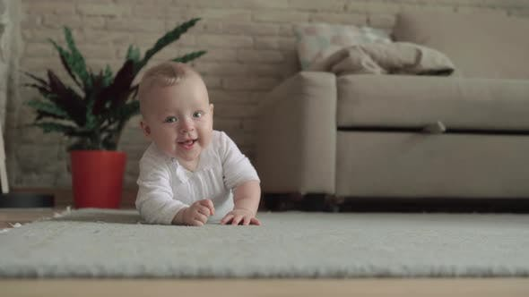 Thumbnail for Lovely Eight Months Baby Girl on the Floor at Home