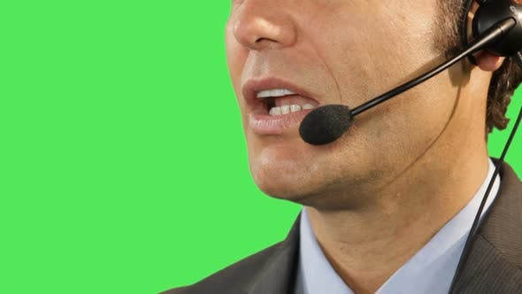 close up of business male talking on headphone