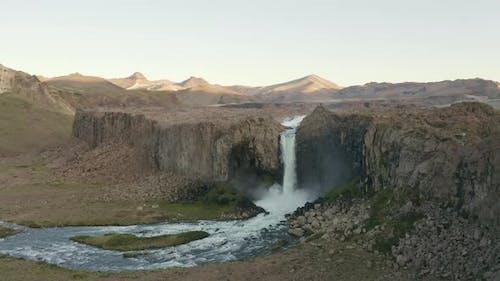 Waterfall in barren landscape, Tromso, Norway