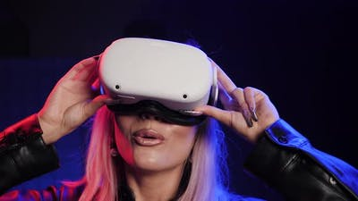 Happy People in VR Goggles