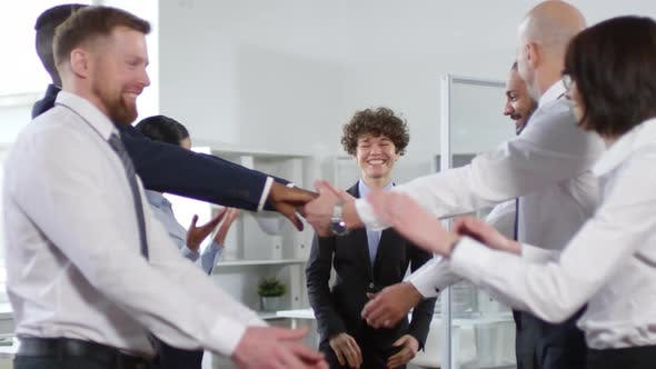 Thumbnail for Happy Colleagues Playing Trust Game