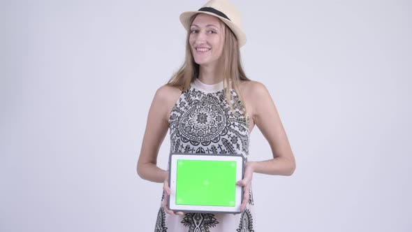 Thumbnail for Portrait of Happy Blonde Tourist Woman Showing Digital Tablet