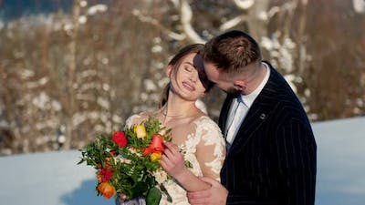 the Bride and Groom on the Background of the Mountains
