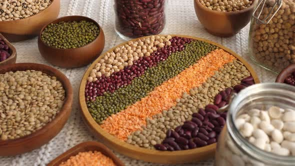 Thumbnail for Beans In Wooden Bowls And Jars. Nutrition, Healthy Vegan Lifestyle.