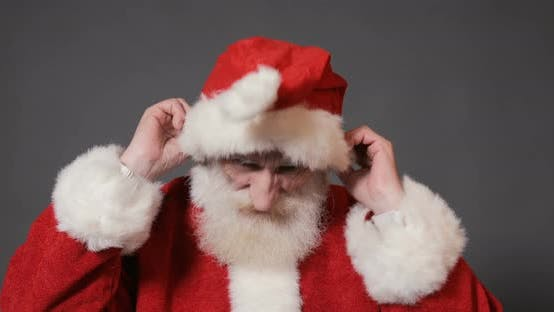 Thumbnail for Santa Puts on Red Hat