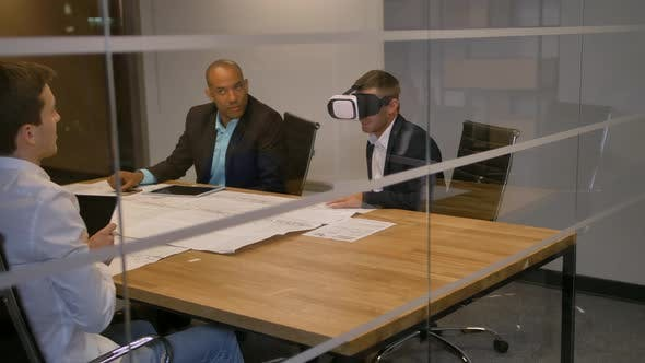 Thumbnail for Business Team Sitting at a Table, Man with Virtual Reality Goggles. People Testing Vr Glasses in