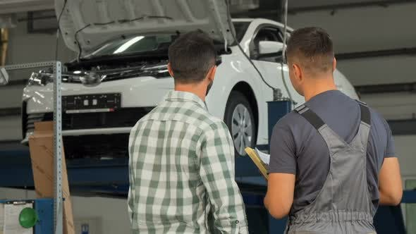Thumbnail for Rear View Shot of a Mechanic and Customer Shaking Hands at the Garage