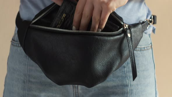 Thumbnail for Female Hand Put a Passport in a Bag. Tourist Woman Take Documents To Travel in Hip Pack Belt Bag