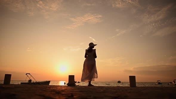 Woman Enjoying Summer Sunset in the Marina
