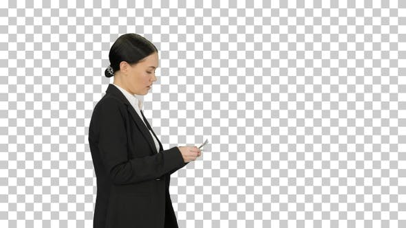 Thumbnail for Young woman in a suit counting money, Alpha Channel