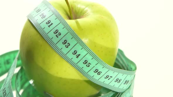 Thumbnail for Green Apple with Measuring Tape on White, Rotation, Reflection