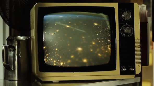 Cover Image for Earth at Night seen from Space on a Retro TV.
