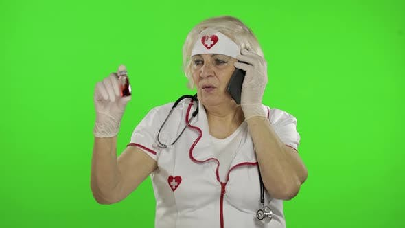 Thumbnail for Elderly Female Doctor Talking on the Phone with Patient. Coronavirus. Covid-19