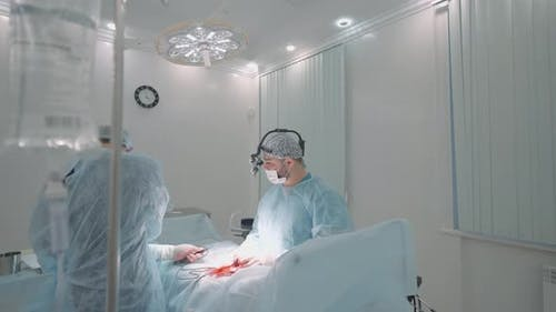 Process of surgery in a hospital operating theater