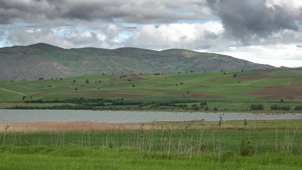 Thumbnail for Green Moorland and Fields Around The Lake