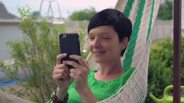 Thumbnail for Female Messaging on Cellular at the Open Air