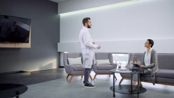 Thumbnail for Male Doctor Greeting Patient and Asking Her to Follow Him