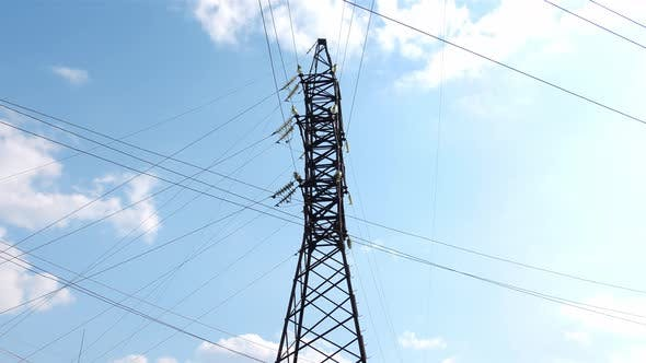 Long-distance Power Transmission Lines. High-voltage Poles That Efficiently Transmit Thousands of