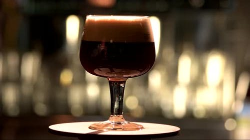 Snifter Glass with Black Stout Beer Exposition