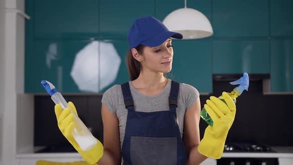 Thumbnail for Smiling Woman from Cleaning Service Comparing Two Spray Cleaning Agents