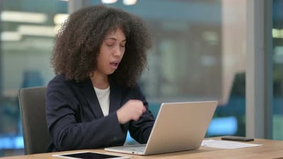African Businesswoman with Laptop Coughing