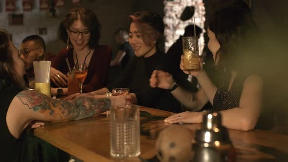Cover Image for Young Friends Clinking Glasses with Cocktails