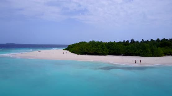 Thumbnail for Wide birds eye travel shot of a white sandy paradise beach and turquoise sea background in vibrant 4