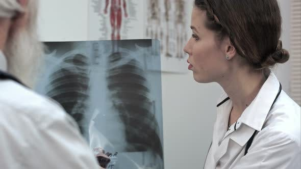 Thumbnail for Doctor Explaining X-ray Results To Senior Patient