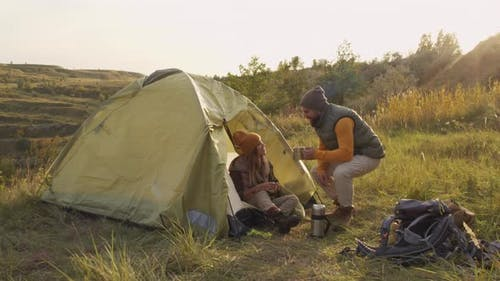 Couple Camping on Sunny Day