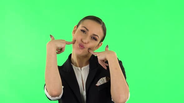Thumbnail for Trendy Girl Poses for Camera Makes Funny Faces. Green Screen
