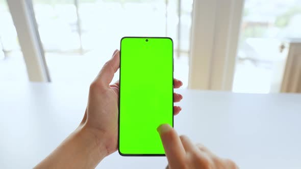 Thumbnail for Female Hands Using a Smartphone with a Green Screen in Vertical Mode. Chroma Key. POV
