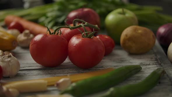 Thumbnail for Anonymous Person Taking Fresh Red Tomatoes From Wooden Table