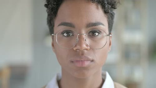Portrait of Beautiful African Girl Wearing Glasses