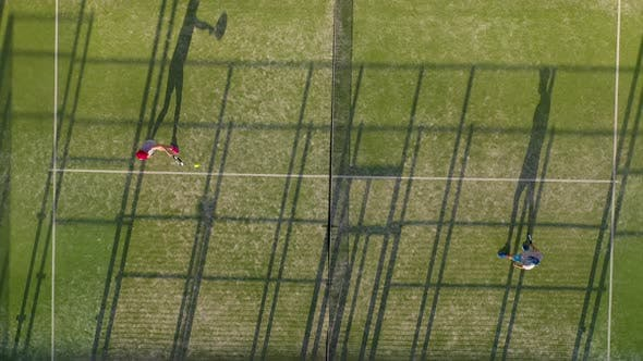 View From the Height of the Tennis Court Where People Play in the Tennis