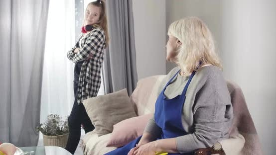 Thumbnail for Senior Caucasian Woman Educating Teen Girl Standing with Irritated Facial Expression and Turning