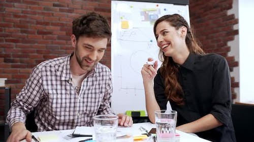 Slow Motion of Two People Friendly Talking During Teamwork Talking and Having Fun at Workplace Man
