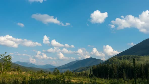Thumbnail for Forested Mountains And Floating Clouds Time Lapse