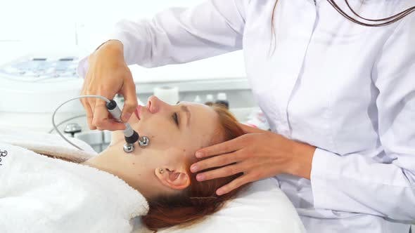 Thumbnail for Cosmetologist Uses Iontophoresis for Client's Face