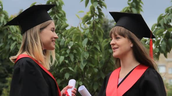 Cover Image for Beautiful Females Graduates Discussing Future Plans After Receiving Diplomas