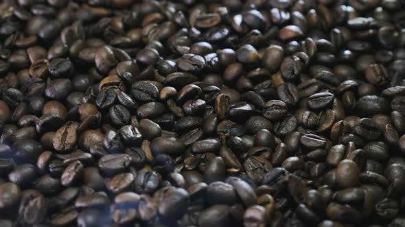 Thumbnail for Fresh fragrant coffee beans with roasted smoke,