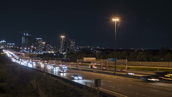 Thumbnail for Motion Time Lapse Of Night Time Busy City Highway