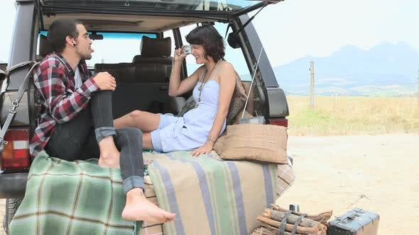 Thumbnail for Couple in back of suv with camera