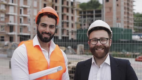 Thumbnail for Portrait of the Happy Builder and Businessman Looking at the Camera Standing on the Construction