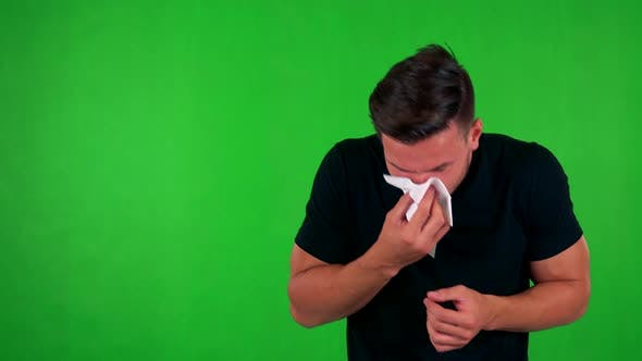 Thumbnail for Young Handsome Caucasian Man Blow One's Nose - Green Screen - Studio
